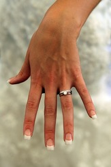 Hand with diamond engagement ring